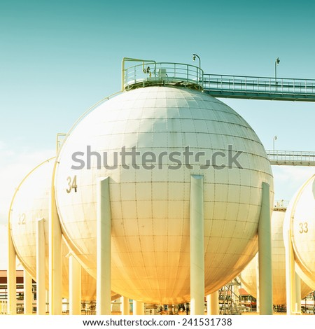 Spherical oil tank, toned image - stock photo