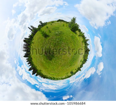 Spherical panorama of a green meadow with trees and blue cloudy sky - stock photo