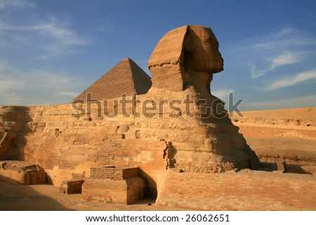 sphinx and great pyramid of Khufu - stock photo