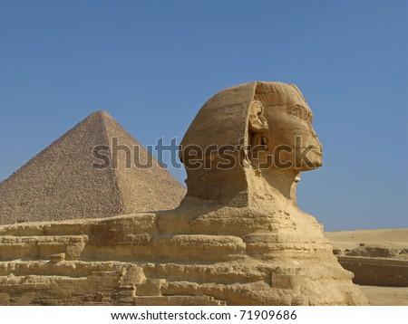 Sphinx and Pyramid at Giza, Cairo - stock photo