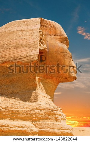 Sphinx face, dramatic sky - stock photo