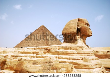 Sphinx Head and pyramid on Giza, Egypt - stock photo