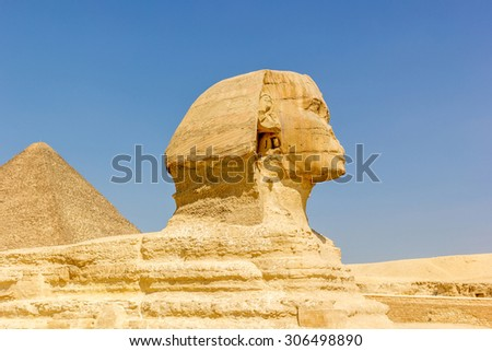 Sphinx statue and pyramid of Cheops on the background, Egypt
