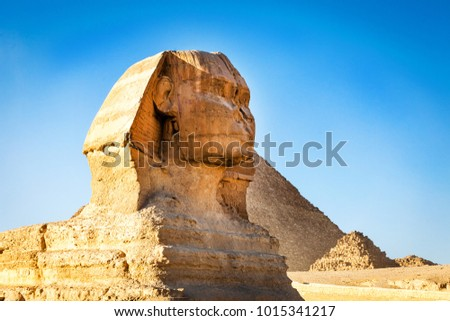 Sphinx with pyramids at sunset in Egypt