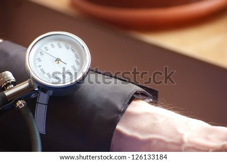 sphygmomanometer indicating the low  blood pressure indicating the low  blood pressure - stock photo