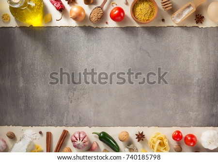 spice and herbs ingredients at stone background