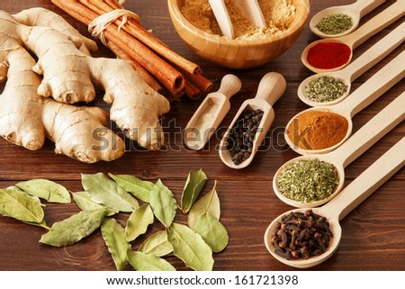 Spice assortment on a wooden table - stock photo