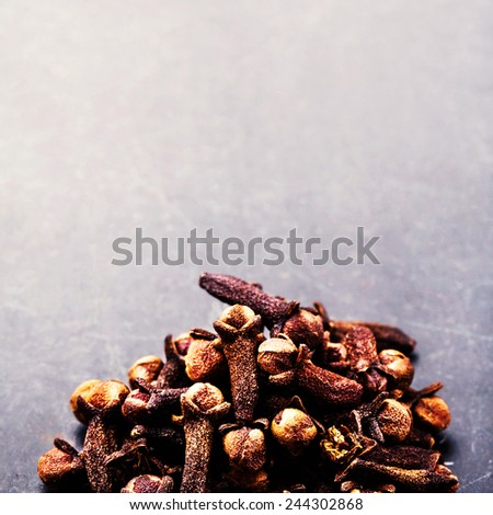 Spice background - various spices over dark table. Collection of different spices. Food backdrop - stock photo