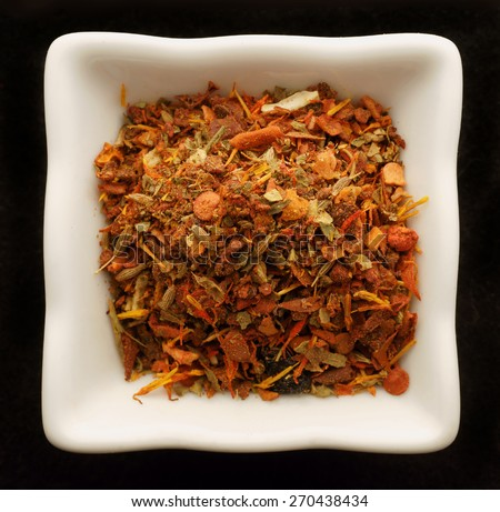Spice for pilaf in a ceramic bowl. Isolated on black. - stock photo