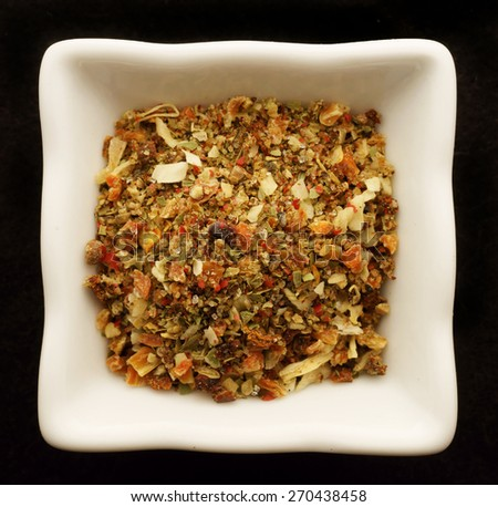 Spice in the ceramic bowl. Isolated on black. - stock photo