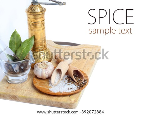 Spice in Wooden Spoon isolated white background