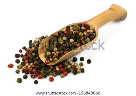 spice mix of peppers in a wooden scoop isolated on white