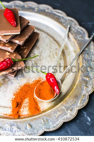 Spice red chilli peppers and chocolate, selective focus