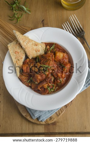 Spiced sausage and cannellini stew with toasted ciabatta - stock photo