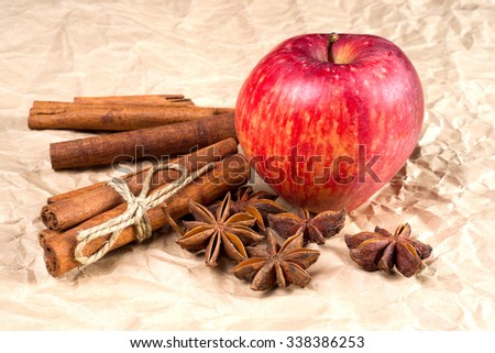 spices and apple on paper background