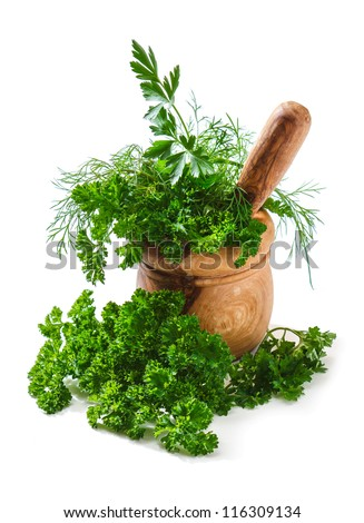 Spices and herbs in a mortar isolated on white background