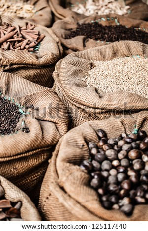 Spices and herbs in bags at market in India ( HDR image ) - stock photo