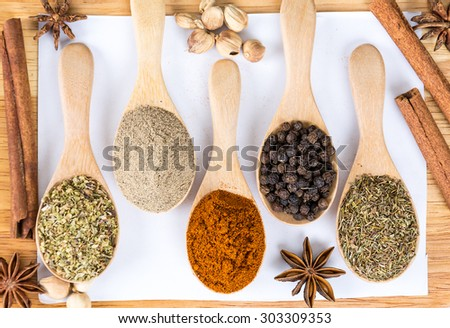 Spices and herbs in bowls. Food and cuisine ingredients.