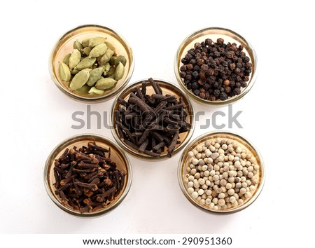 Spices and herbs in glass bowls. Food and cuisine ingredients - stock photo
