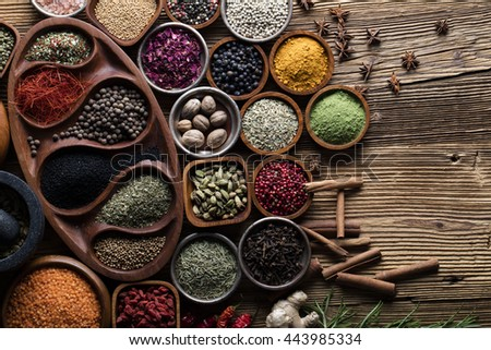 Spices and herbs in metal and wooden bowls. Food and cuisine ingredients. Colorful natural additives.  - stock photo