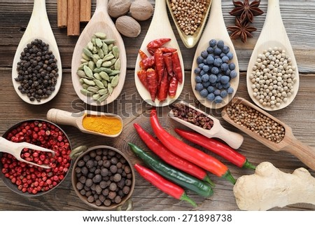 Spices and herbs in metal bowls and wooden spoons. Food and cuisine ingredients - stock photo