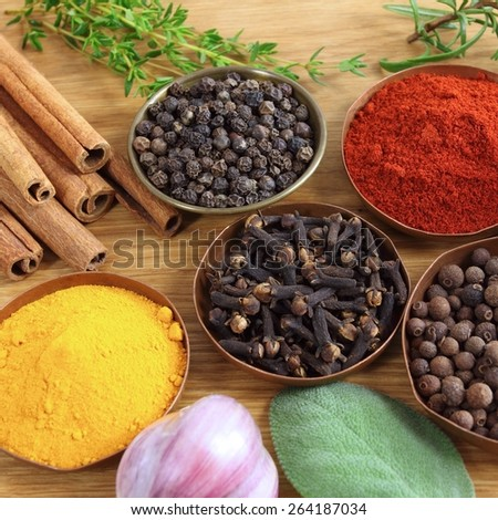 Spices and herbs in metal  bowls. Food and cuisine ingredients. - stock photo