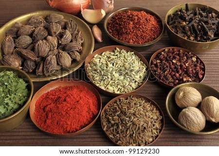 Spices and herbs in metal  bowls. Food and cuisine ingredients.