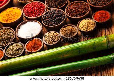 Spices and herbs in wooden bowls. Food and cuisine ingredients.