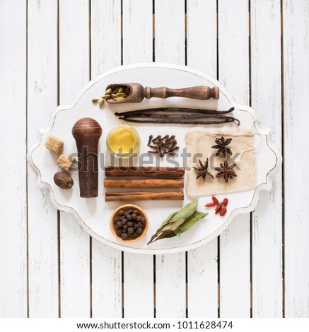 Spices and herbs on white rustic tray