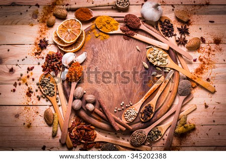 spices and herbs on wooden table. - stock photo