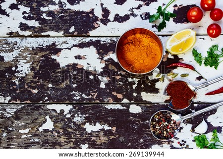 Spices and herbs selection - vintage spoons and old wooden background - cooking, healthy eating. Food concept. Top view. - stock photo