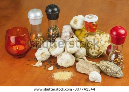 Spices and ingredients to prepare meat for grilling. Garlic, aromatic ingredients for flavoring food. Home remedy for colds and flu. Garlic marinated in olive oil. Seasoning food.
