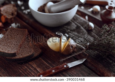 Spices and some kitchen stuff on a dark wooden table