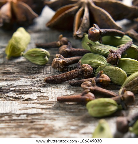 Spices anise stars, cloves and cardamom on the vintage wooden surface - stock photo