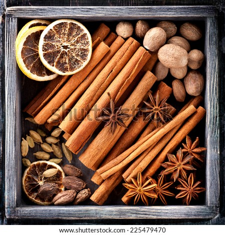Spices for Christmas baking in wooden box - stock photo