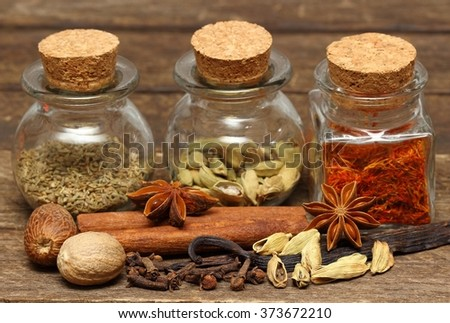 Spices for desserts on the wooden table