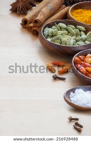 spices for indian cooking, vertical corner background with copy space - stock photo