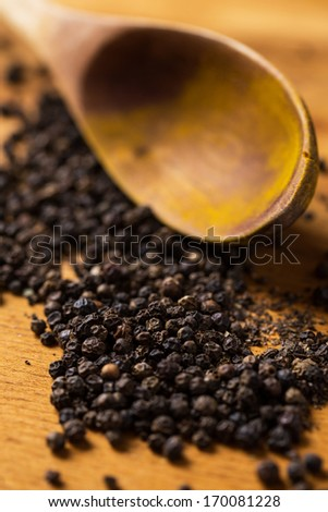 Spices. Heap of pepper on the table - stock photo