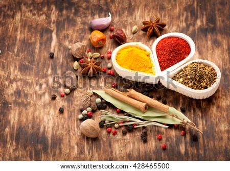 Spices, herbs and spicy on a dark wooden background