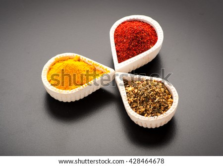 Spices, herbs and spicy on black background