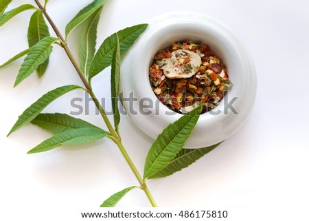Spices in a bowl and Verbena on a table