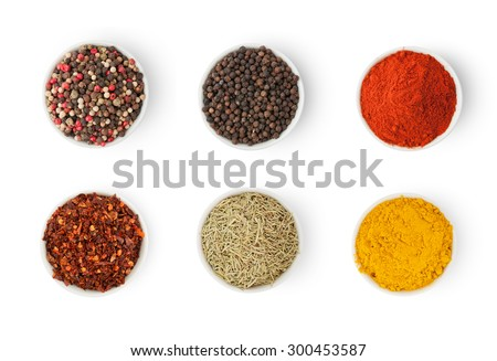 Spices in a bowls isolated on white background, top view