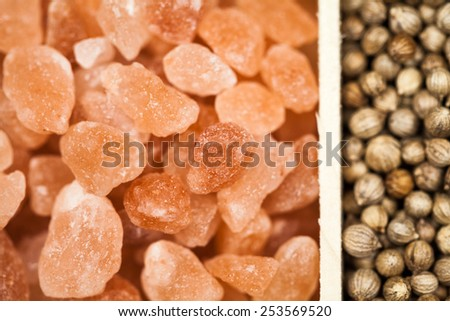 Spices in a wooden box: himalayan salt and coriander - stock photo