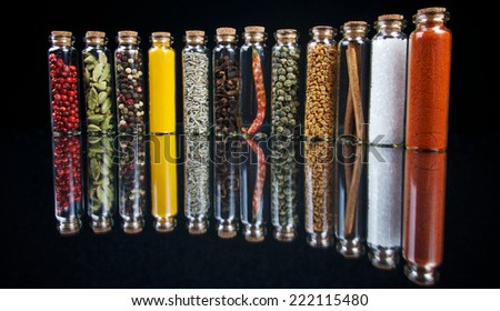 Spices in glass on black background - stock photo