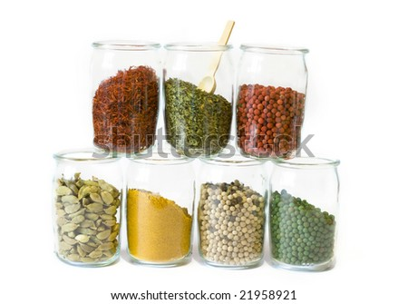 Spices in jars isolated over the white background