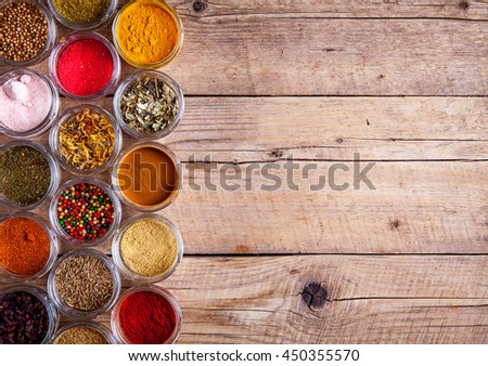 Spices in jars on wooden background. Food - stock photo