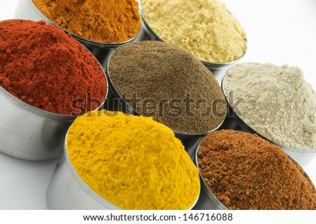 Spices in silver jars on white background - stock photo