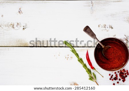 Spices in vintage cup. Herbs and spices selection - old metal cup and white wooden background with space for text. Cooking, food or health concept. - stock photo