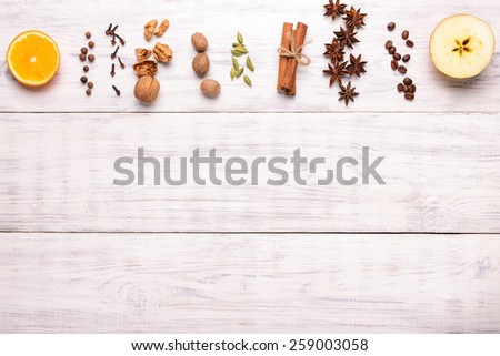 spices ingredients for glintwine on wooden background - stock photo