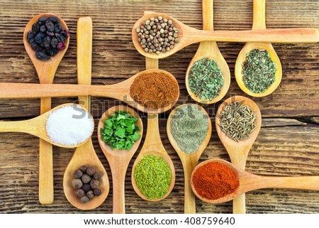 Spices on a wooden background - stock photo